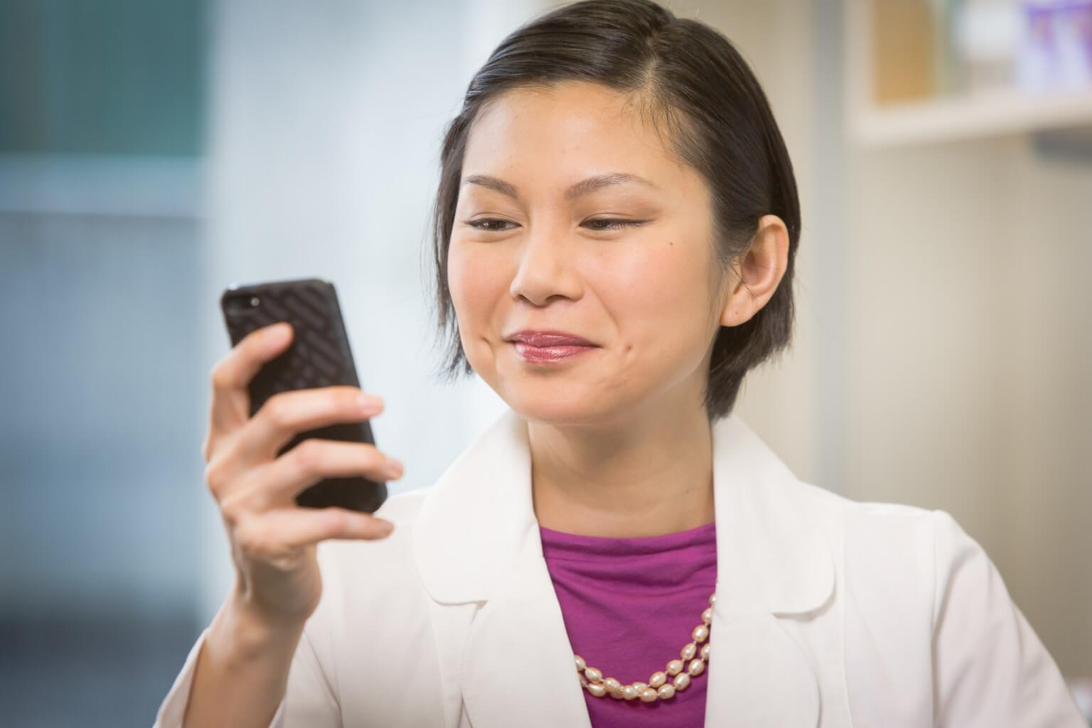 Pharmacists consulting Lexicomp mobile