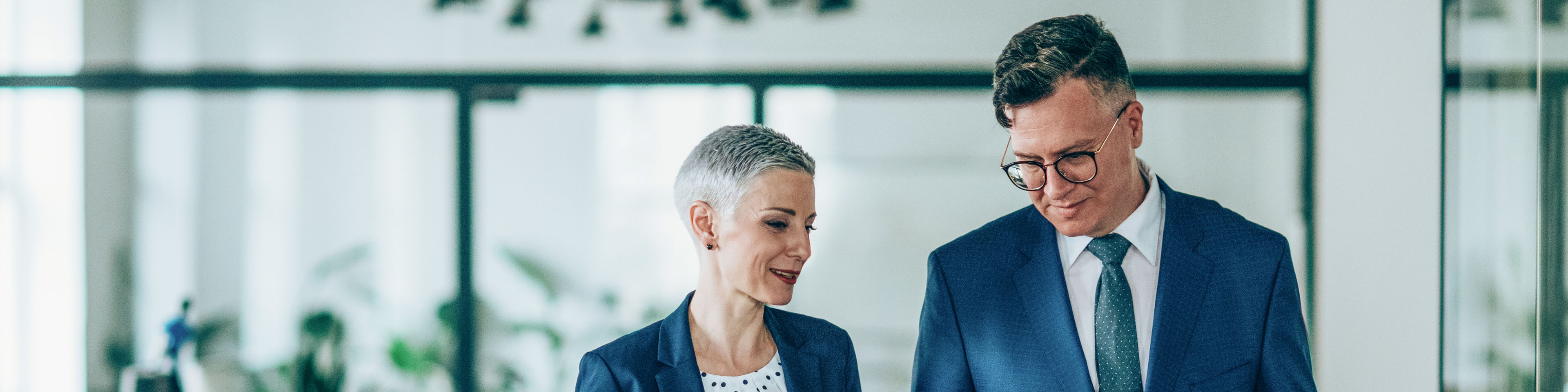 Shot of a businesswoman and businessman talking in the work place