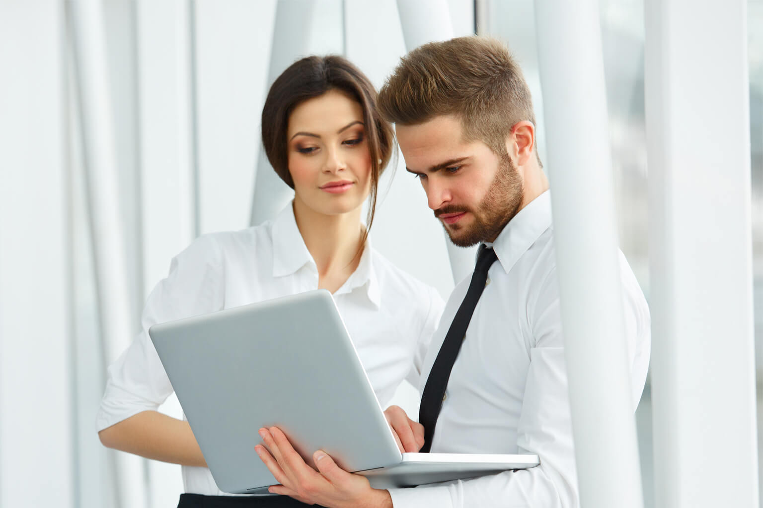 Man and woman discussing business