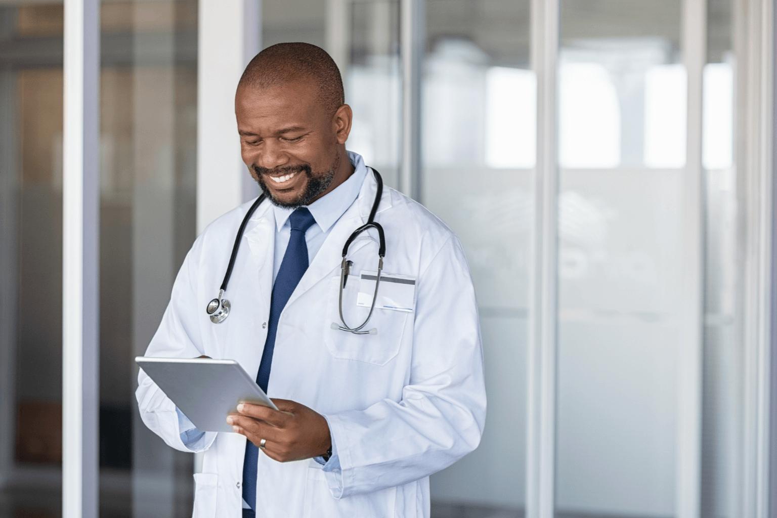 doctor-using-digital-tablet-in-corridor-of-modern-hospital-jpg
