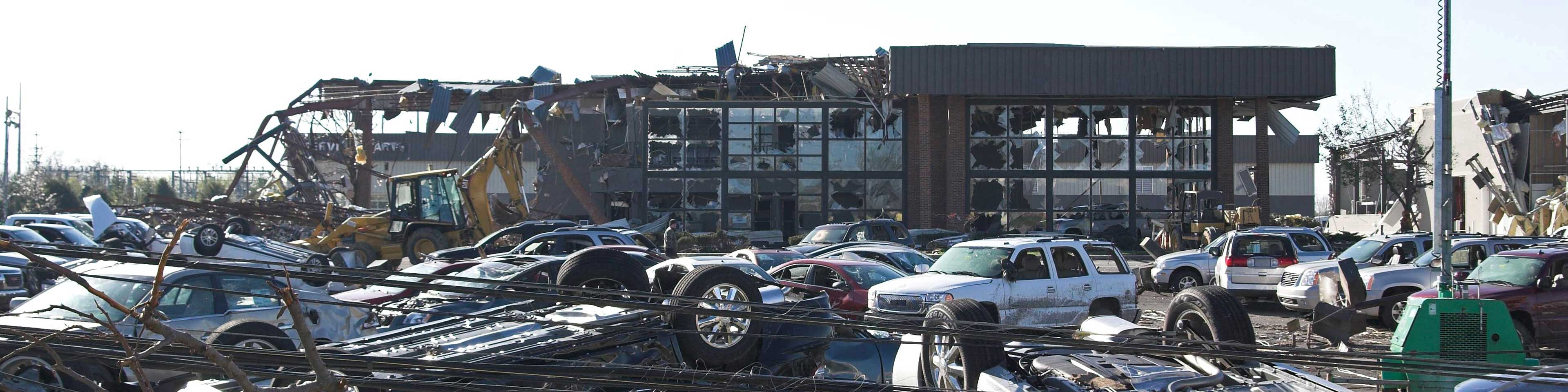 Cars and building destroyed by storm