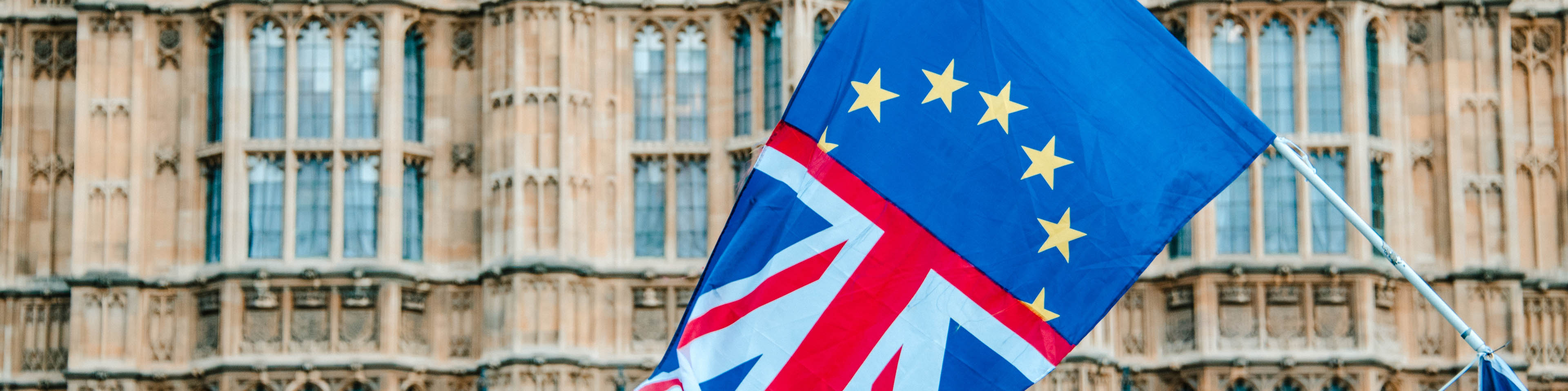 A flag merging the UK and EU flags by Houses of Parliament building in London