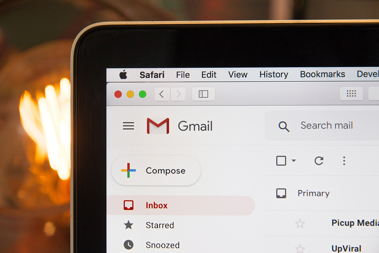 Close-up on corner of laptop screen with Gmail open on it