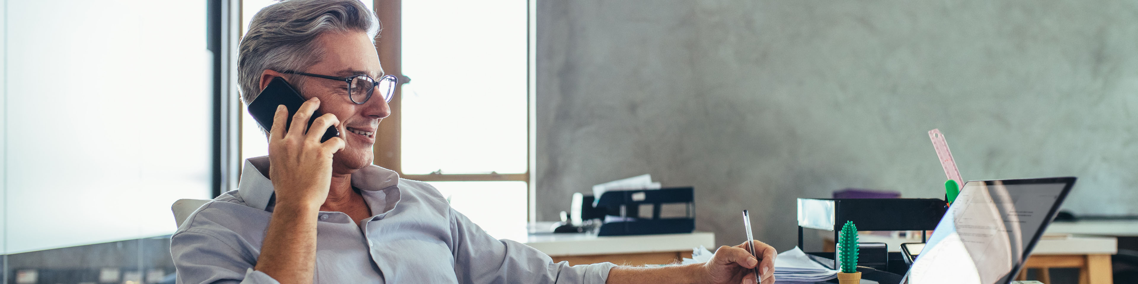 Businessman-in-office-talking-on-phone