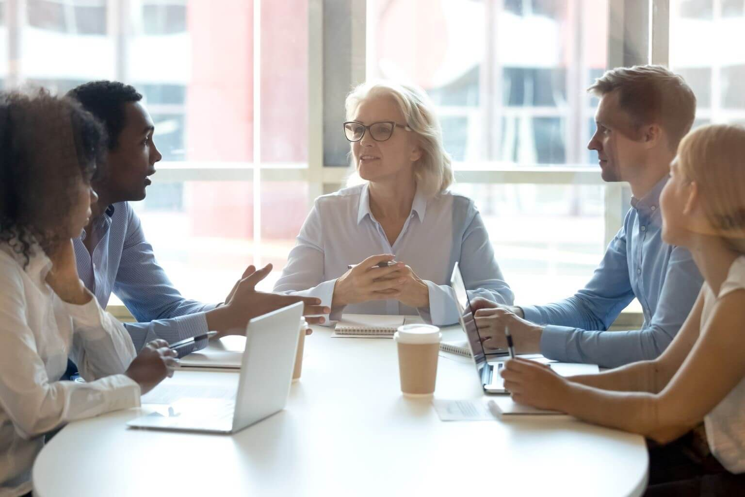 Employees meeting at conference table