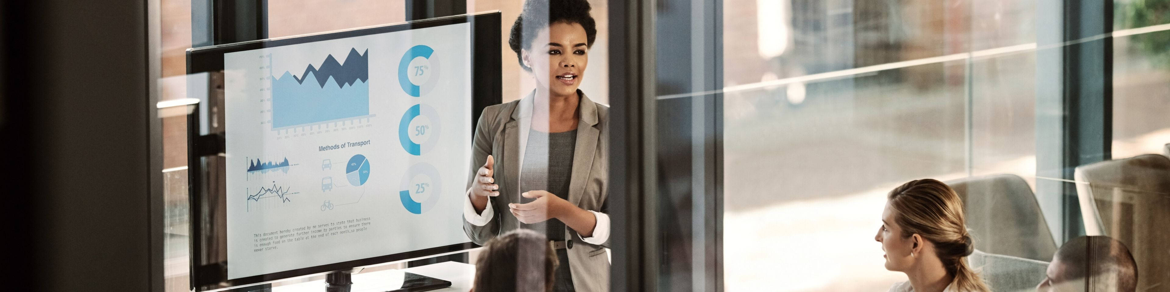 business woman in meeting presenting charts