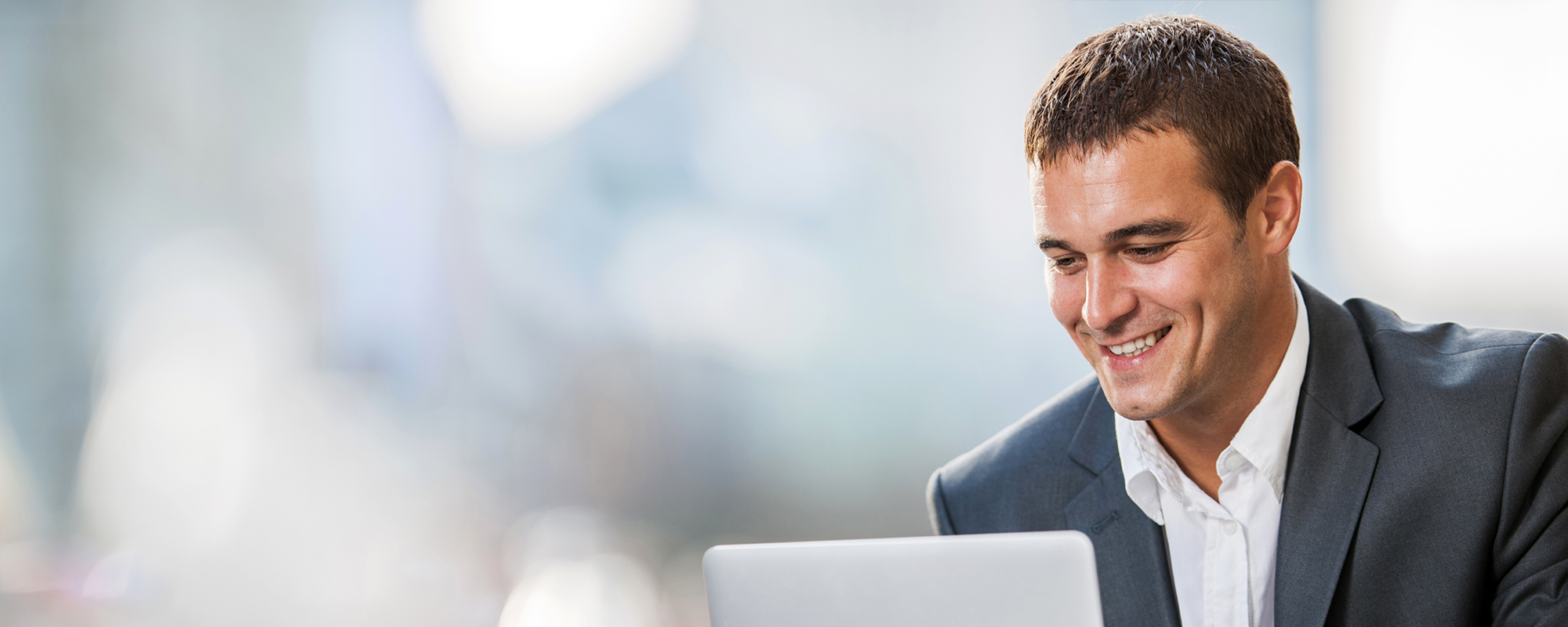 Man looking at computer, using Wolters Kluwer Solutions