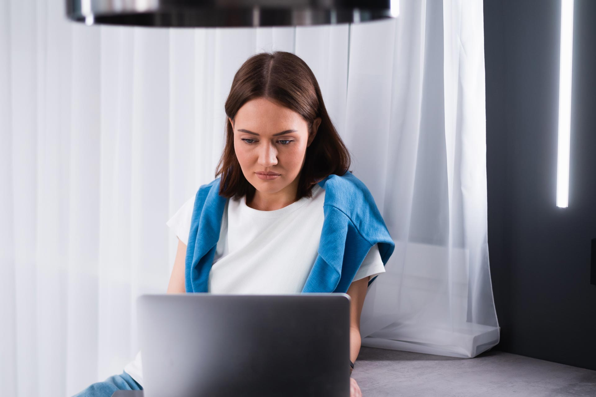 Woman updating her business name on her laptop