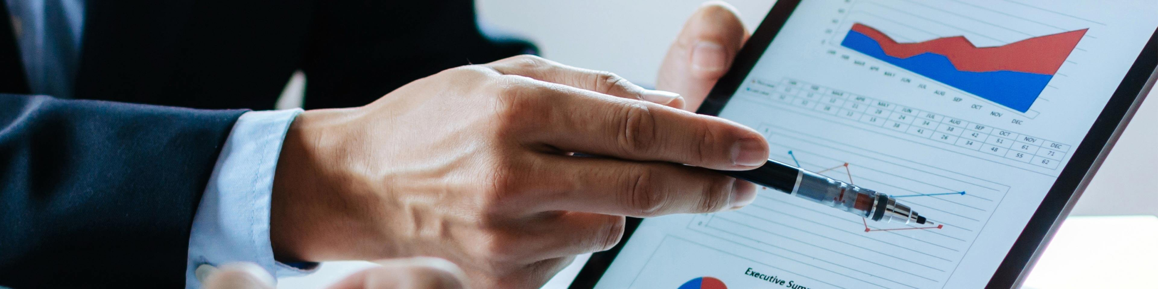 man pointing at a data analytics report in a tablet