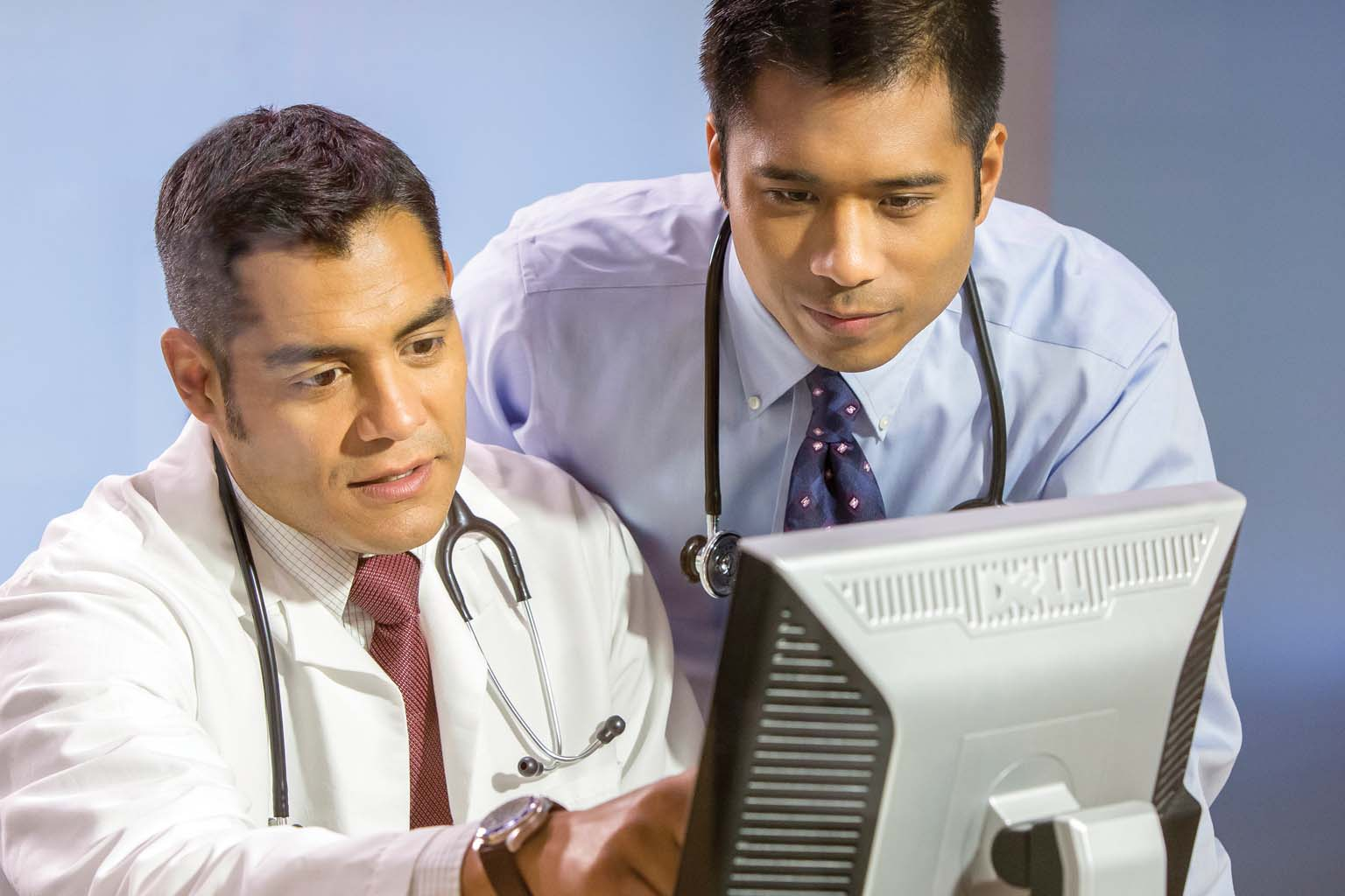 two clinicians at computer screen