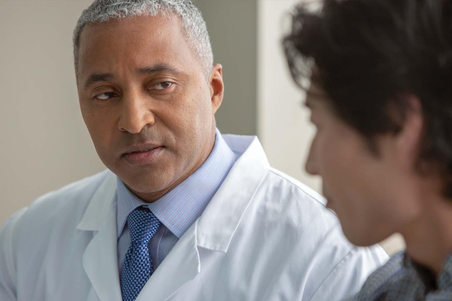closeup of doctor and tech conversing
