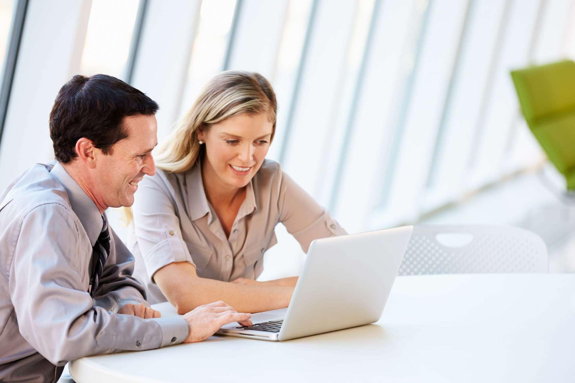 SmartTask and SmartTask Pro business people on laptop