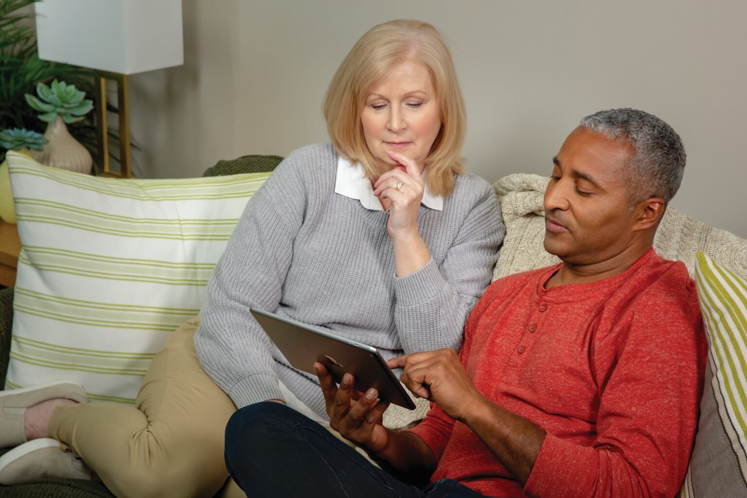 Couple using emmi on their couch