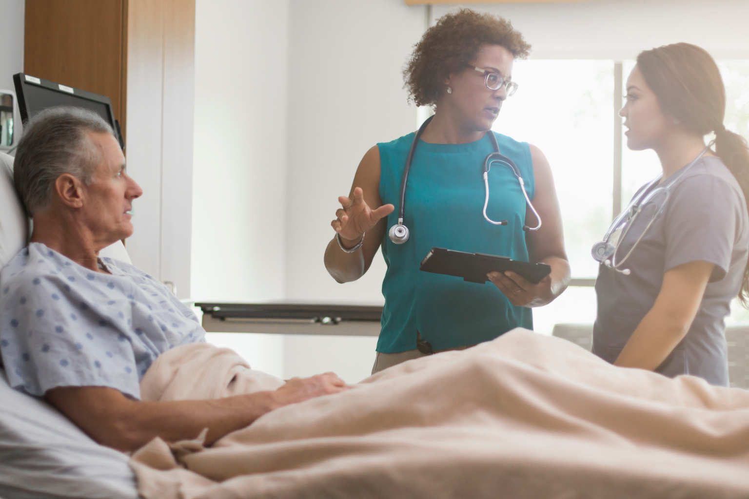 medical professionals confer with patient