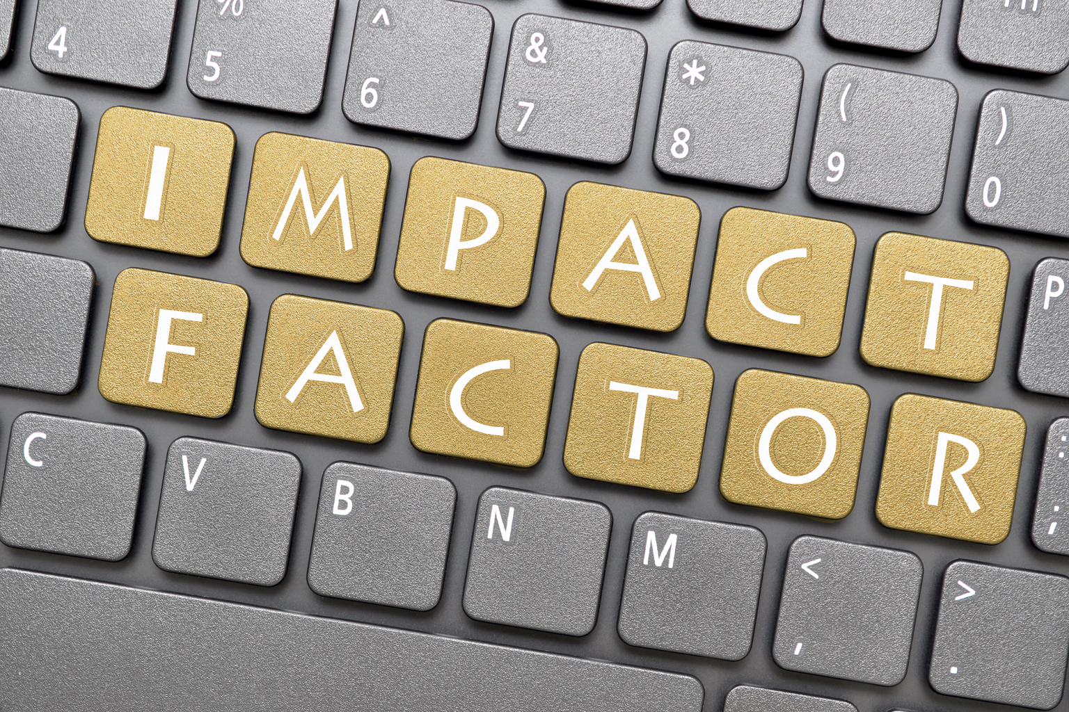 Keyboard with changes to middle letters written to say impact factor