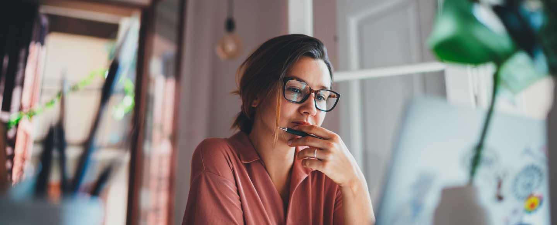 Woman watching a webinar on her computer
