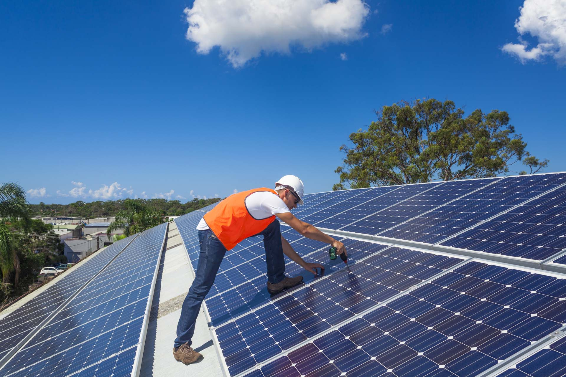 man working on a solar panel.