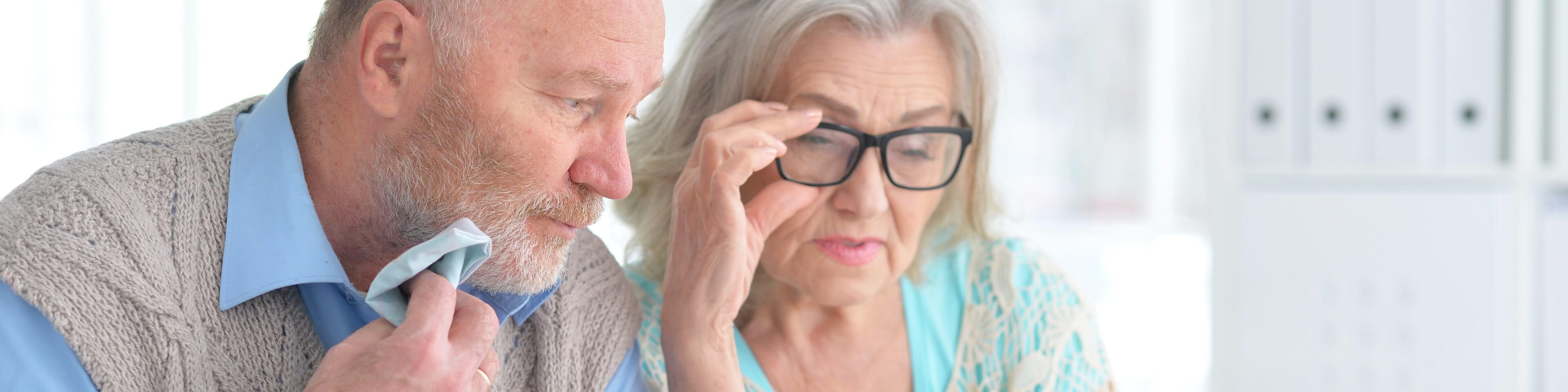 Senior couple reading prescription labels