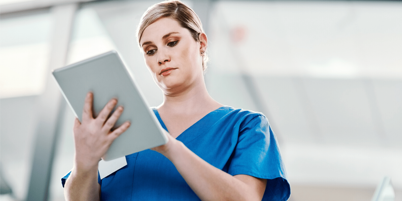 Infection Preventionist on ipad in hospital