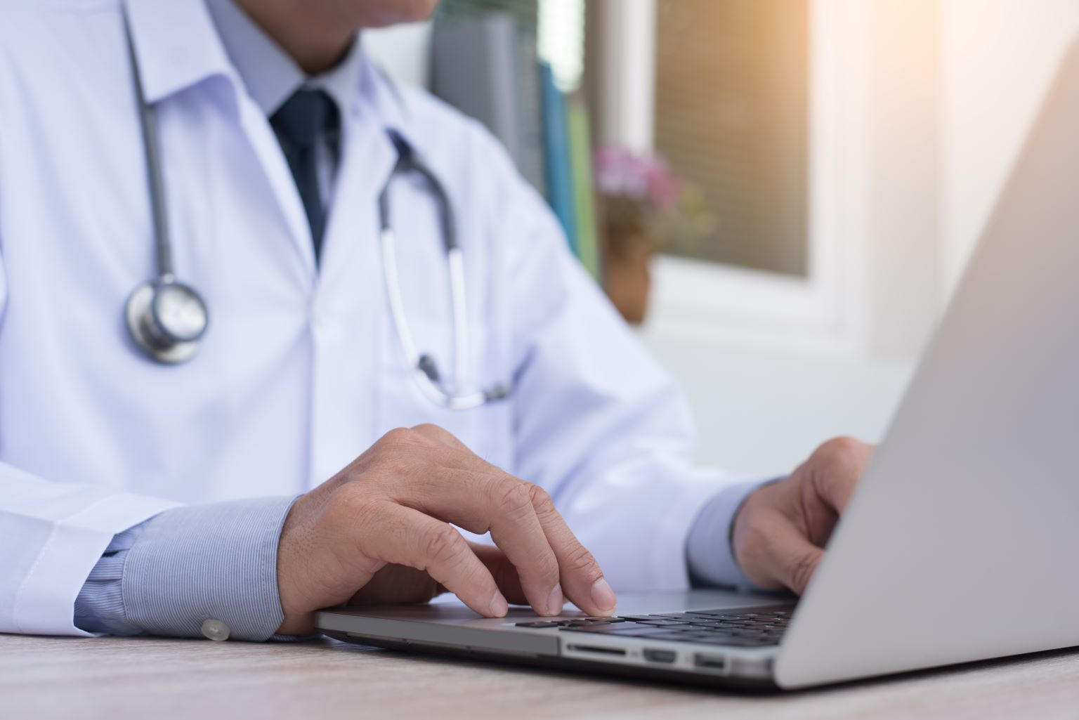 Doctor working on laptop.