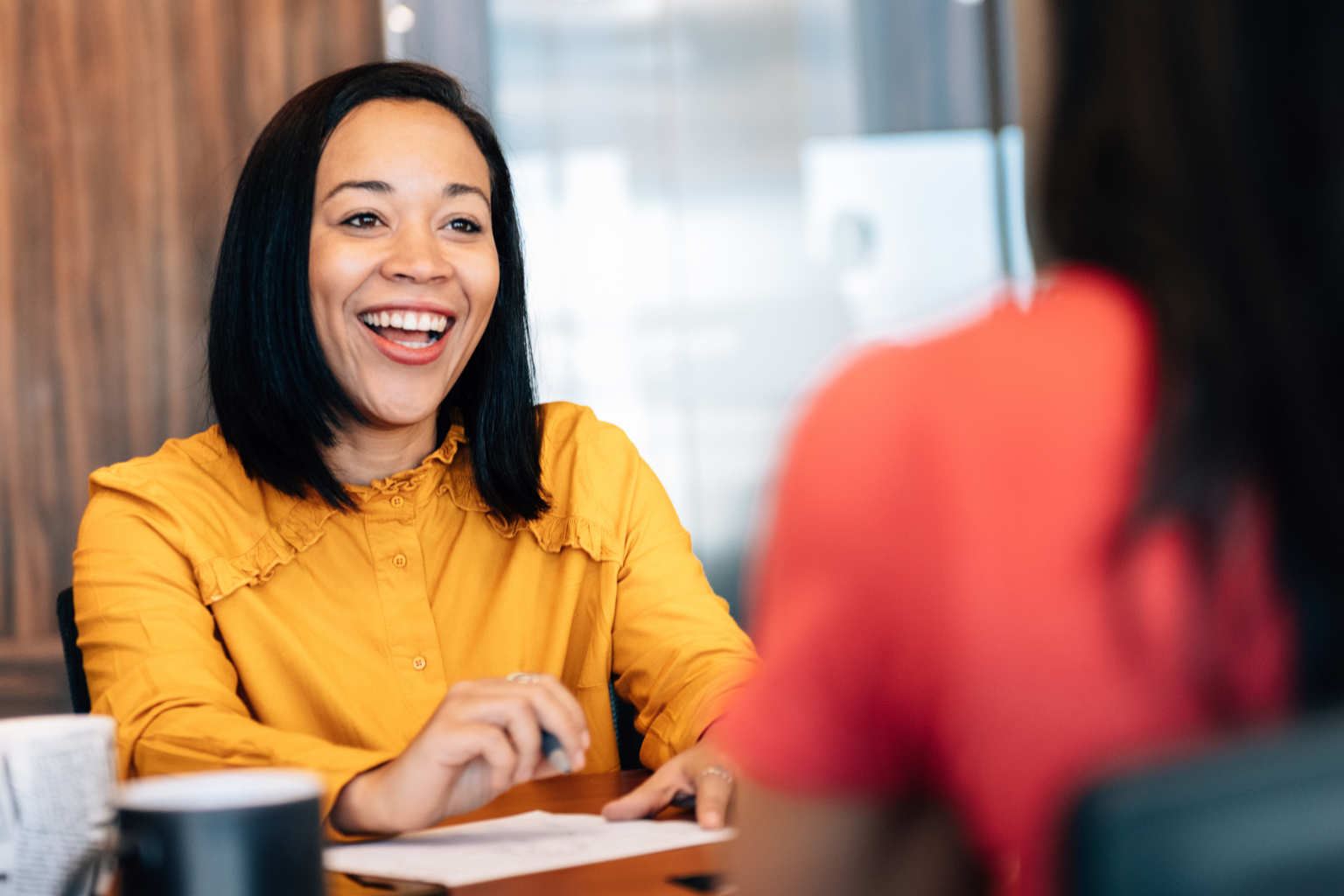 woman engages with client