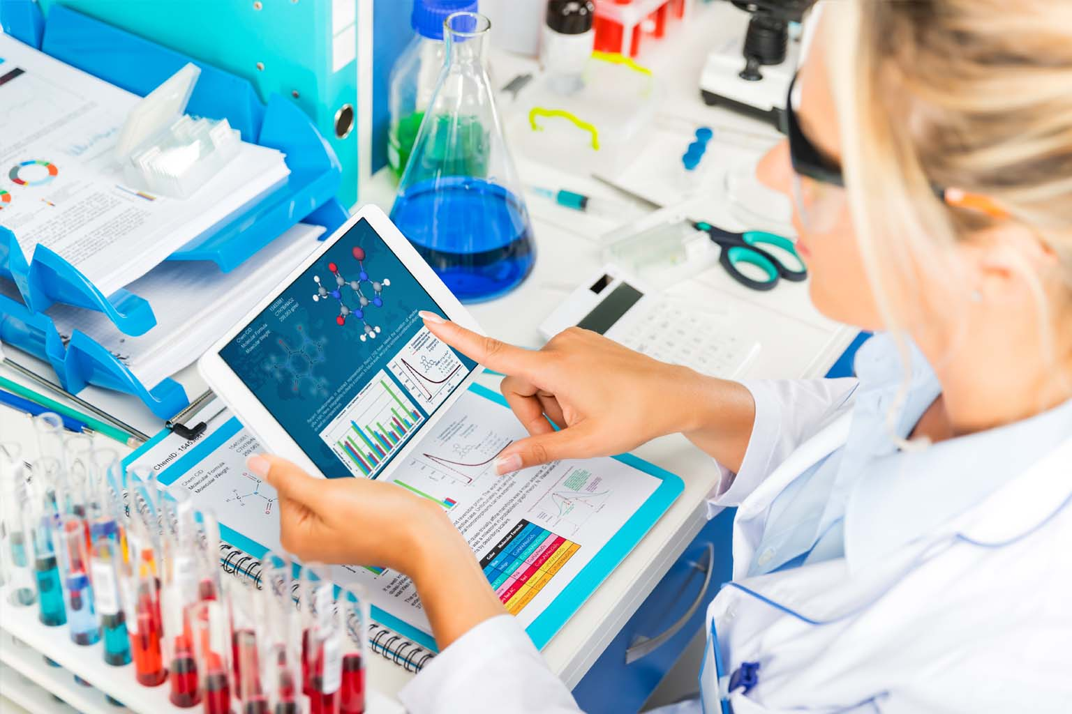 pharmacist in lab using tablet