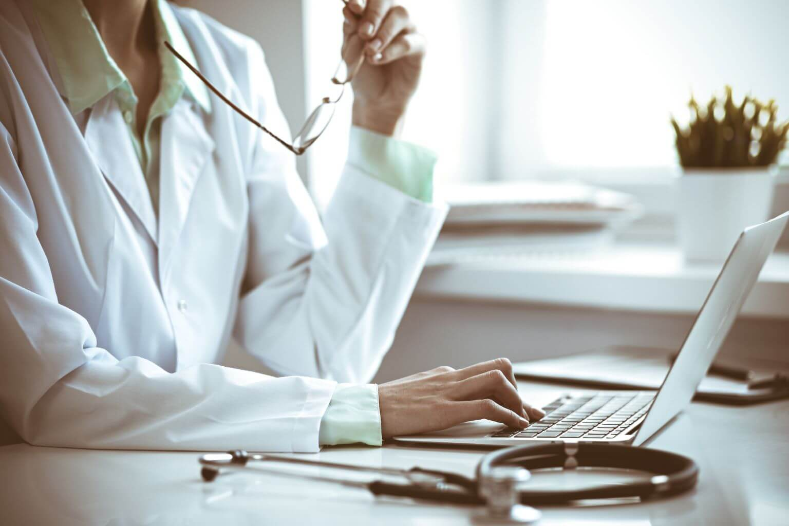 medical-professional-typing-on-computer