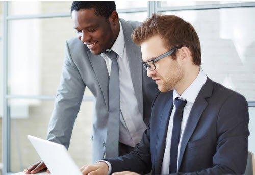 Two men looking at laptop