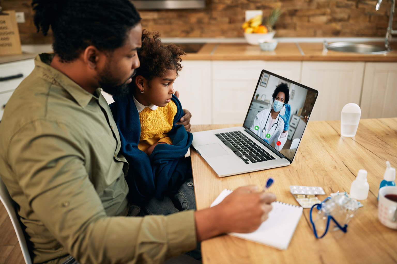 Father on a telemedicine call with child