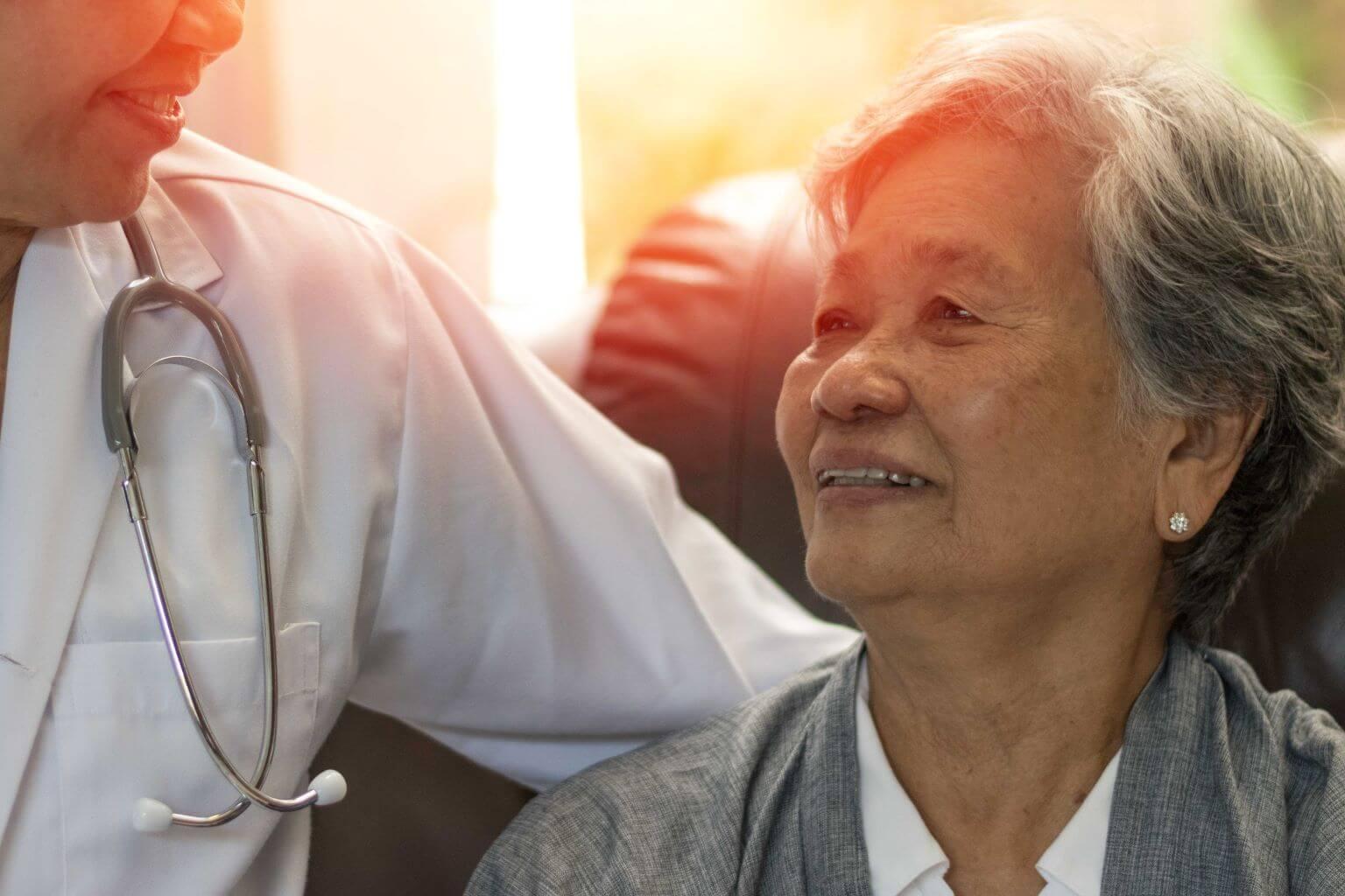 elderly-woman-holding-hands-of-caregiver