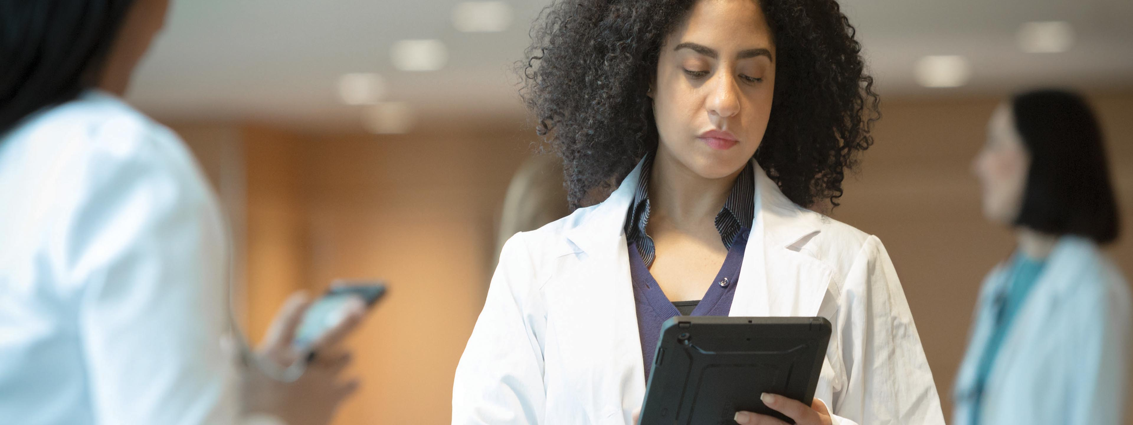young woman white coat tablet