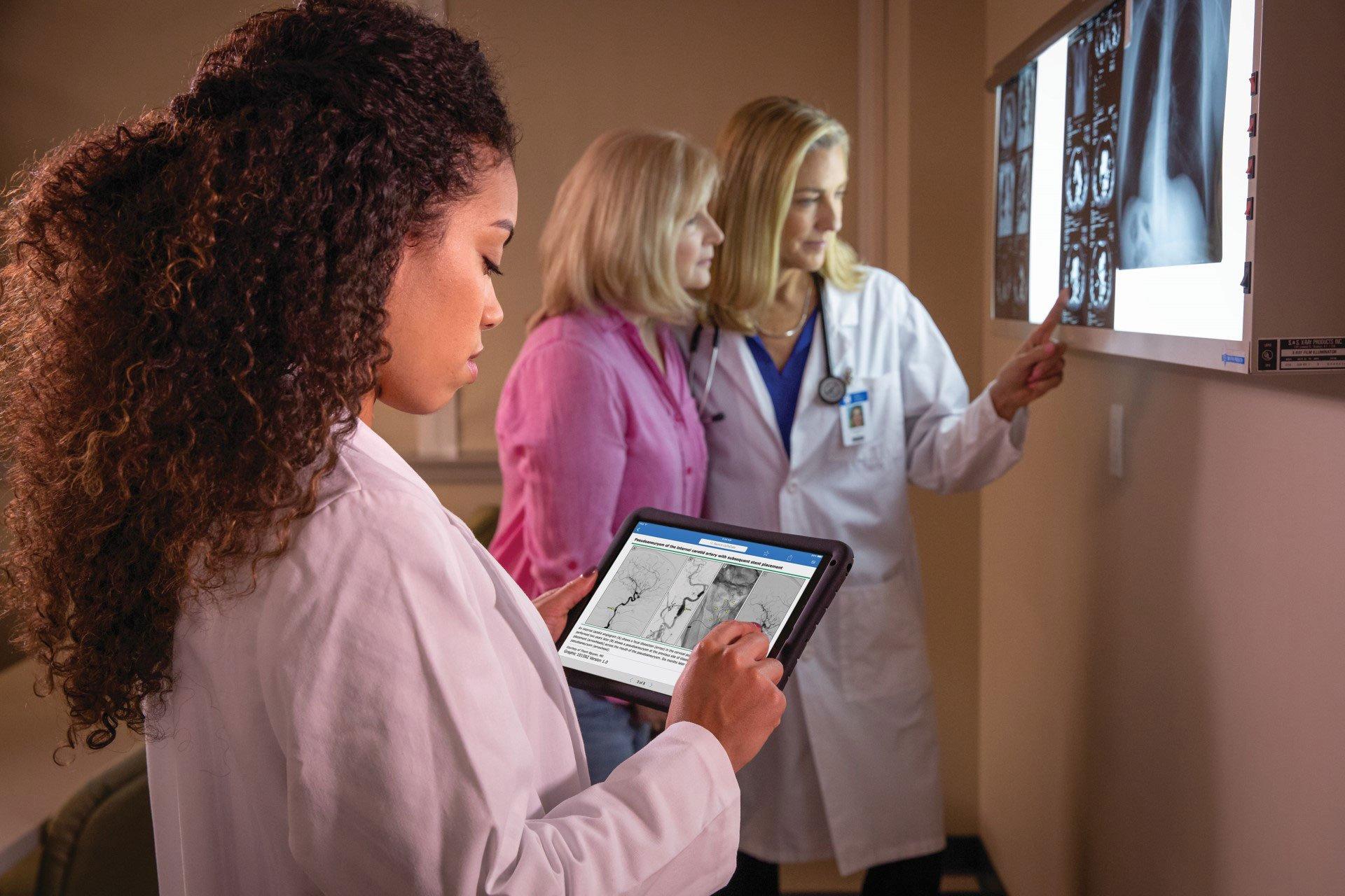 Women doctors diagnosing