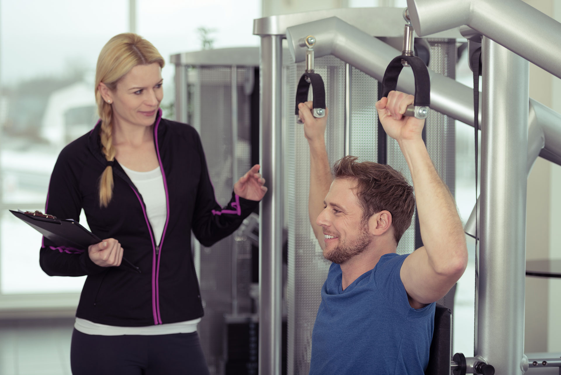 Female trainer working with a male client