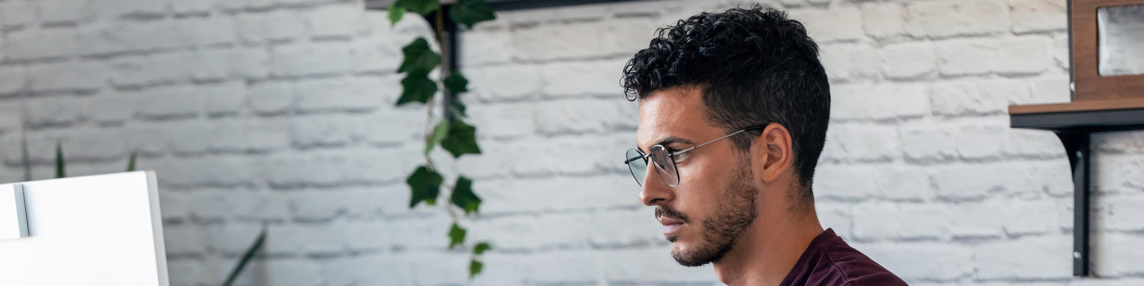 man with glasses reviewing creditors with different rights