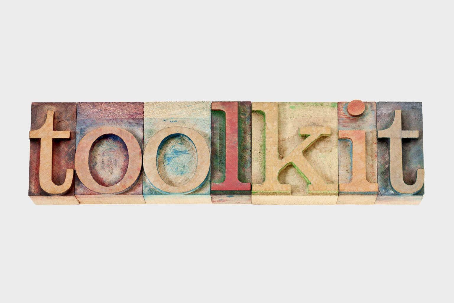 The word toolkit written with stamp letters