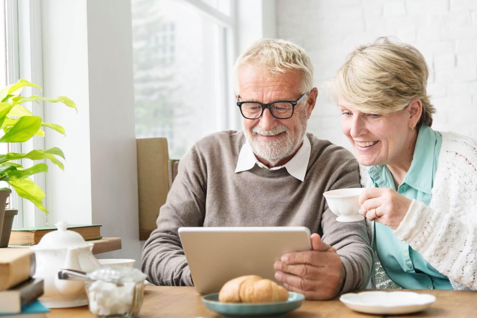 elderly-couple-looking-at-ipad