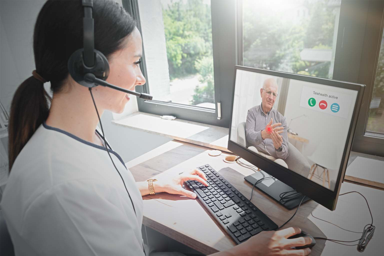 Health care provider at computer on video call with patient