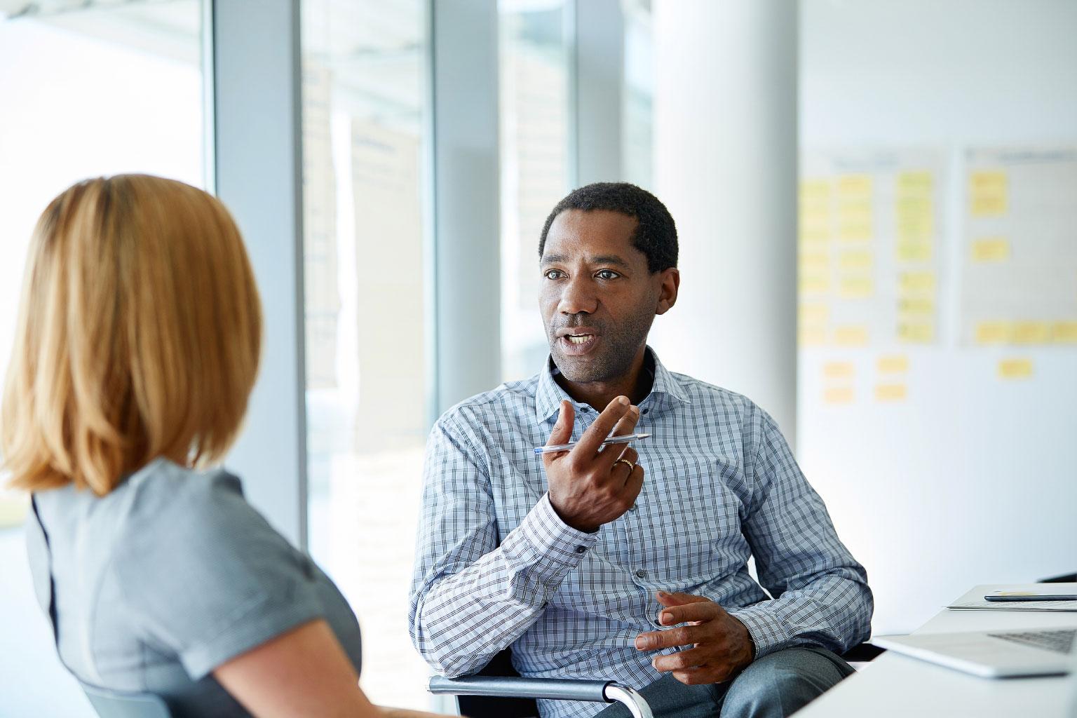Pair discussing finsit financial figures