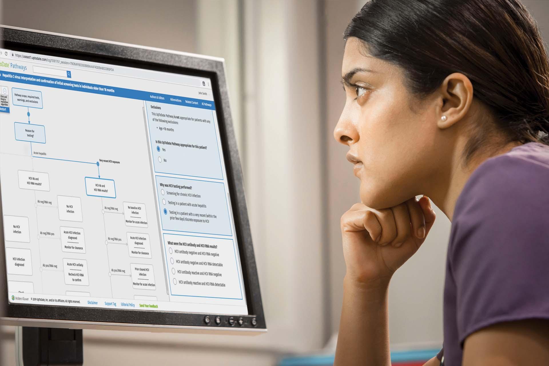 nurse reflecting at computer