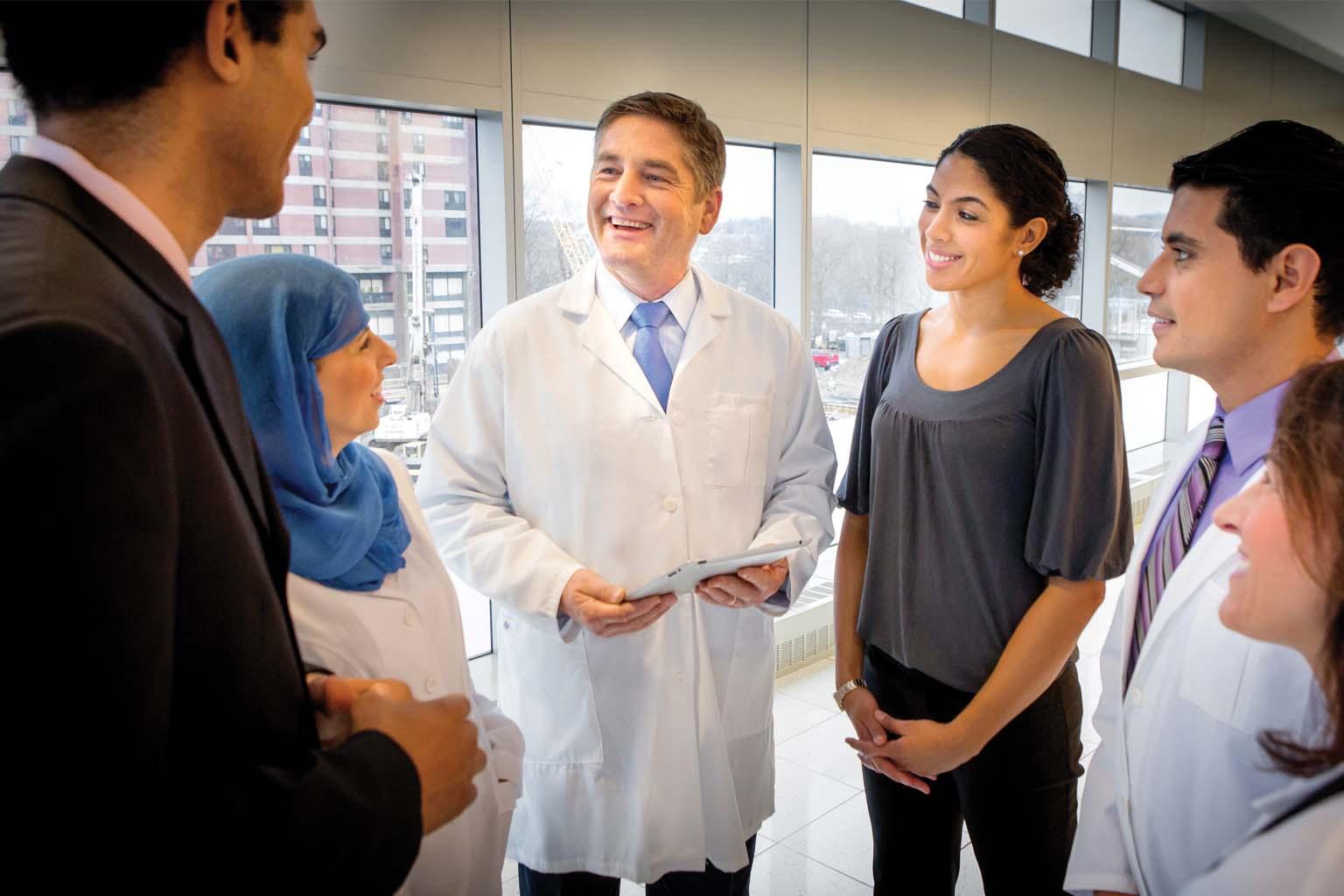 group of doctors talking in hallway