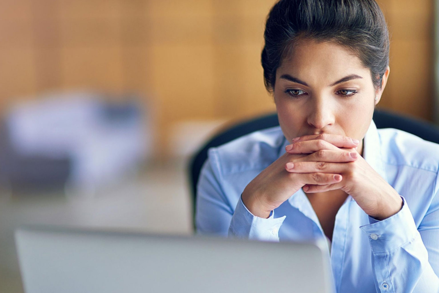 Woman concentrating on screen looking at CCH GDPR Compliance