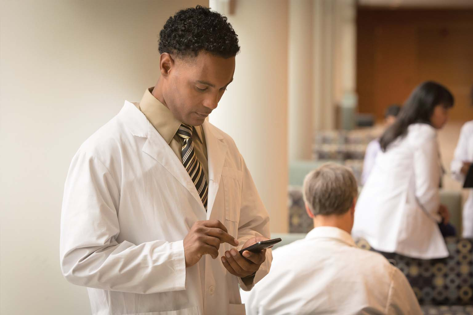 doctor reading information on smartphone