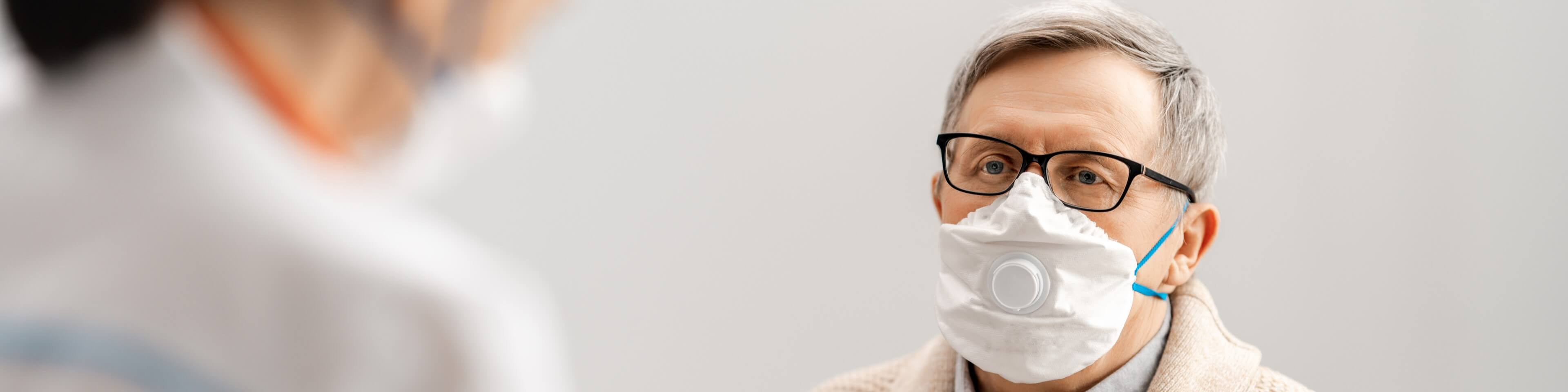 Patient wearing a mask during a doctor's appointment