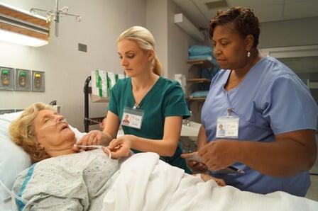 nurses taking care of patient