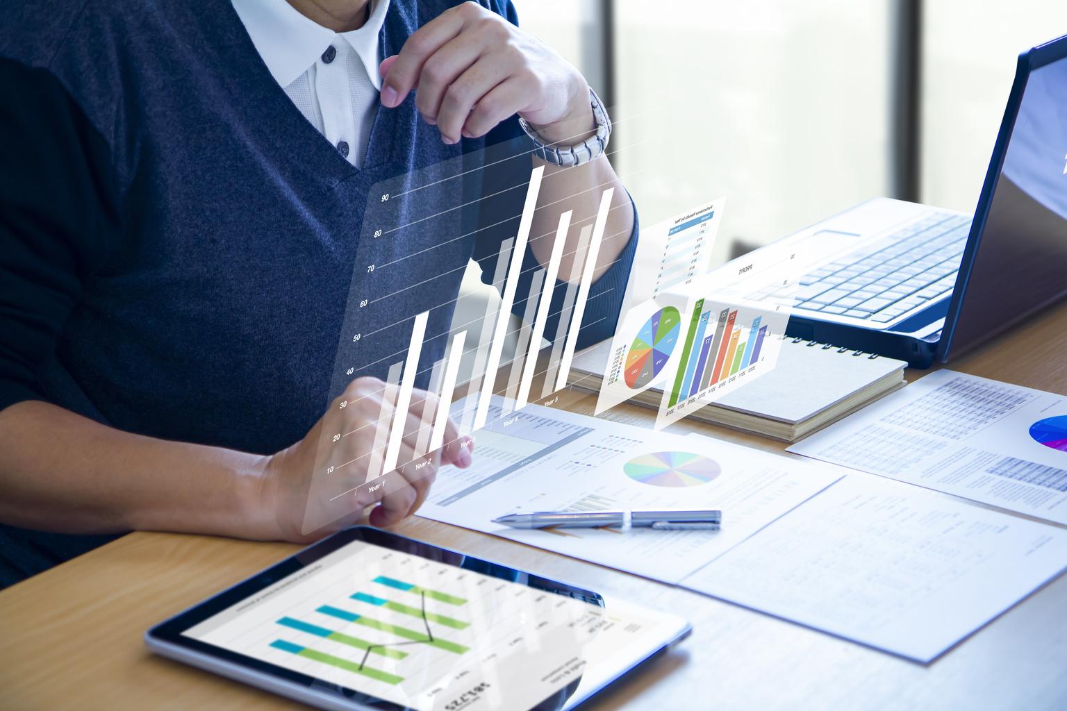 business-man-expanding-futuristic-virtual-screen-modern-tablet