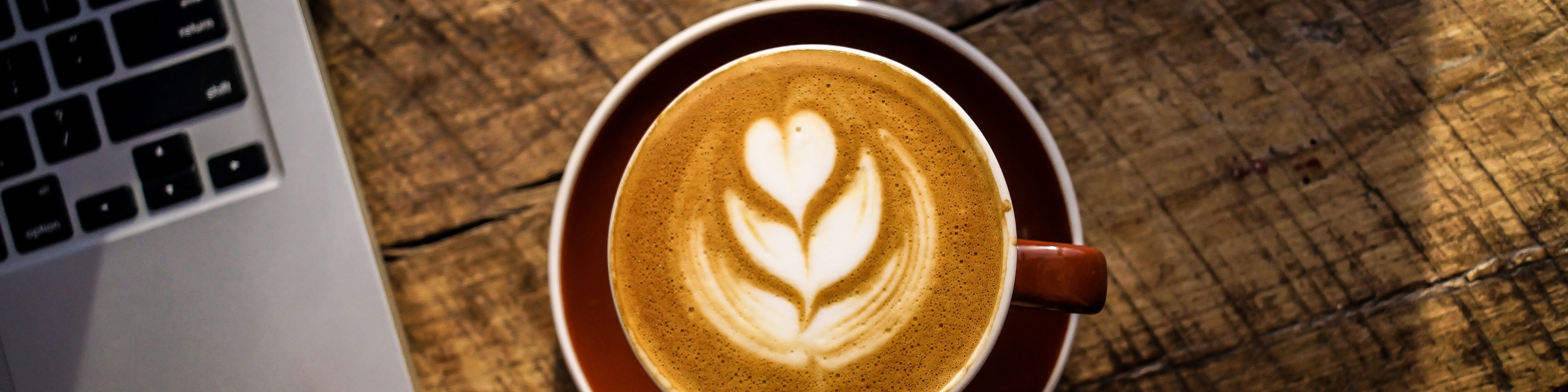 Birdseye view of a latte with heart art drawn on top