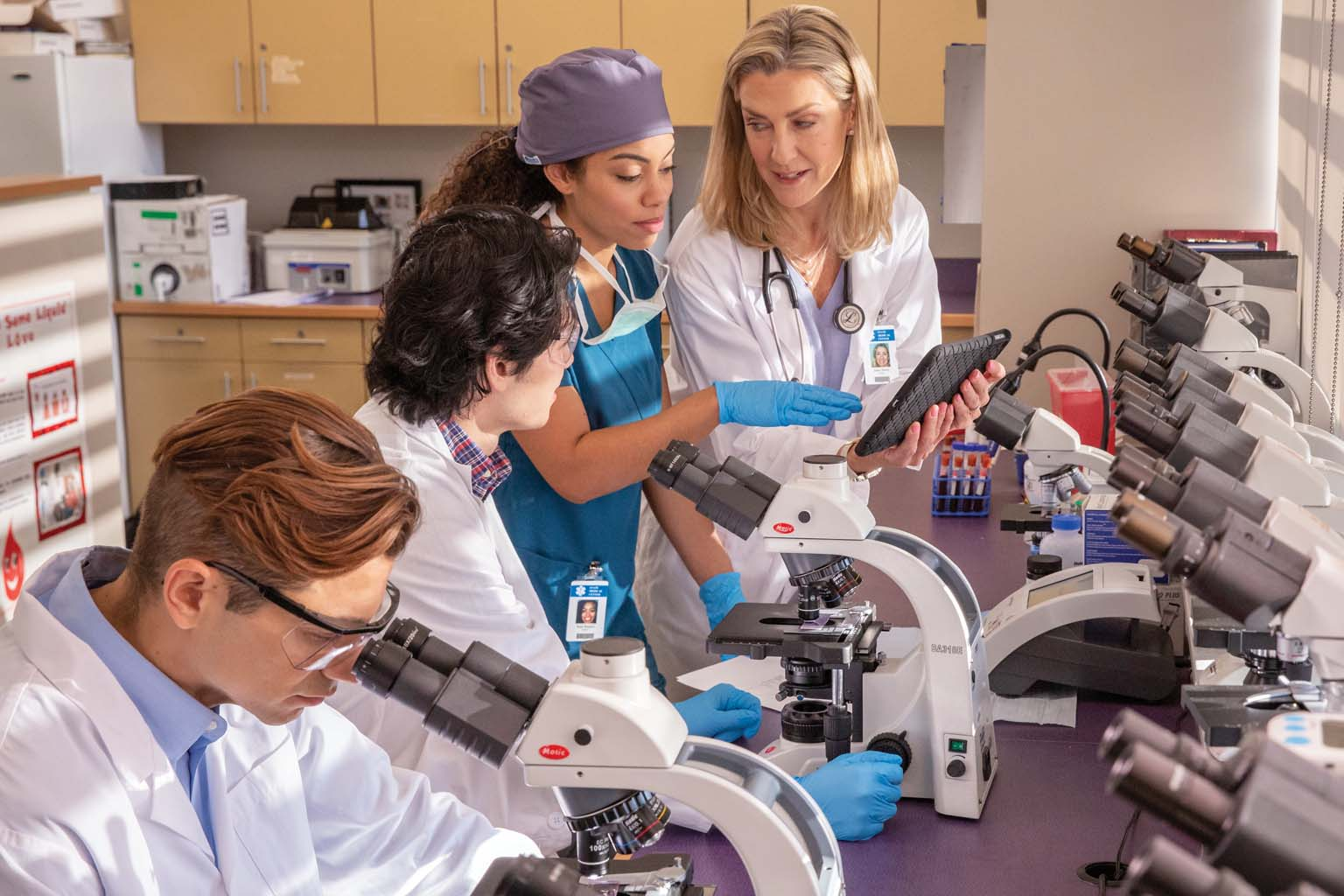 technicians, nurse, and doctor in lab