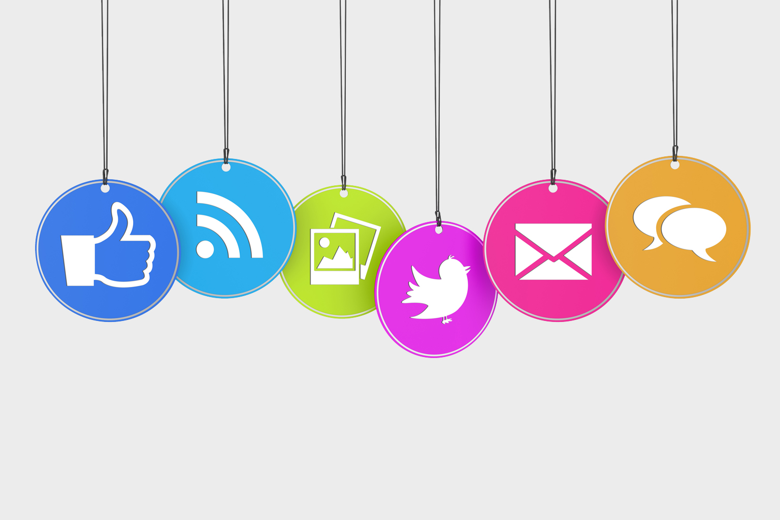 Colorful social media icons hanging from strings