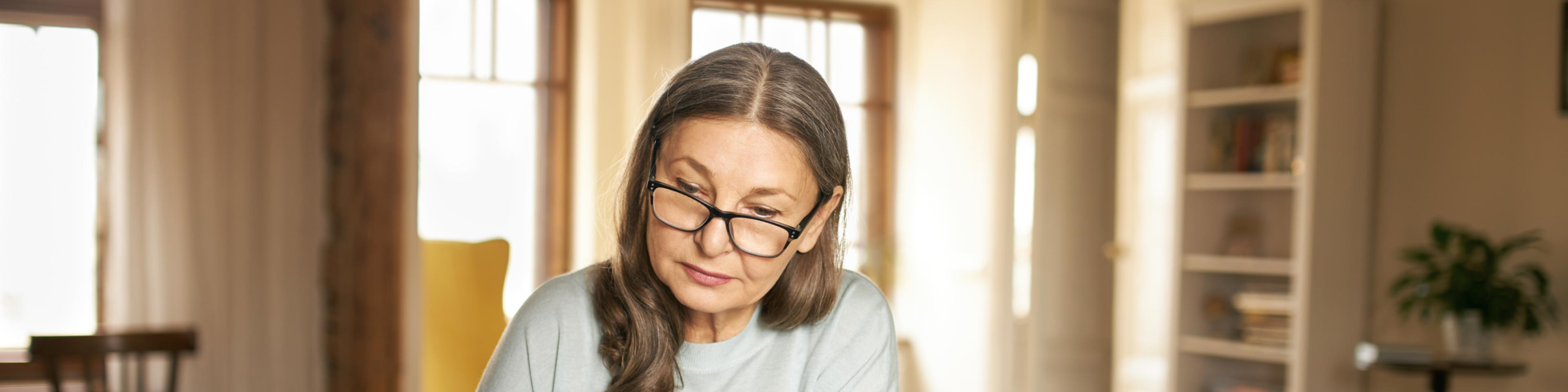 older woman reviewing trust