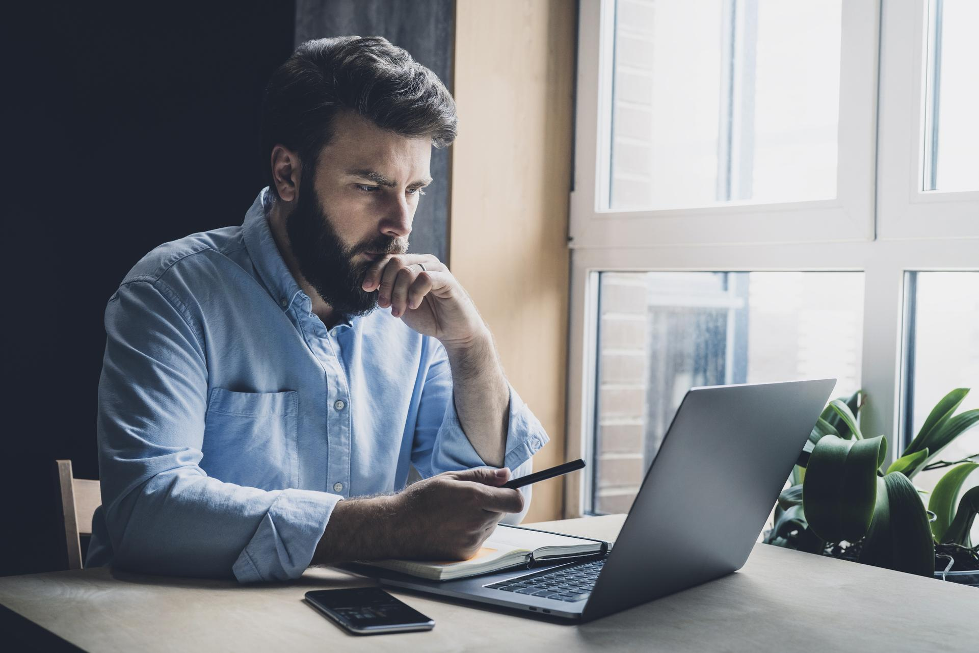 Man studying a computer